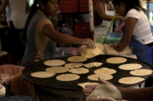 making tortillas in the market